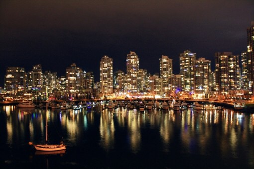 Canadian cityscape reflecting on water at night
