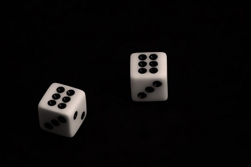 A pair of dice displaying sixes.