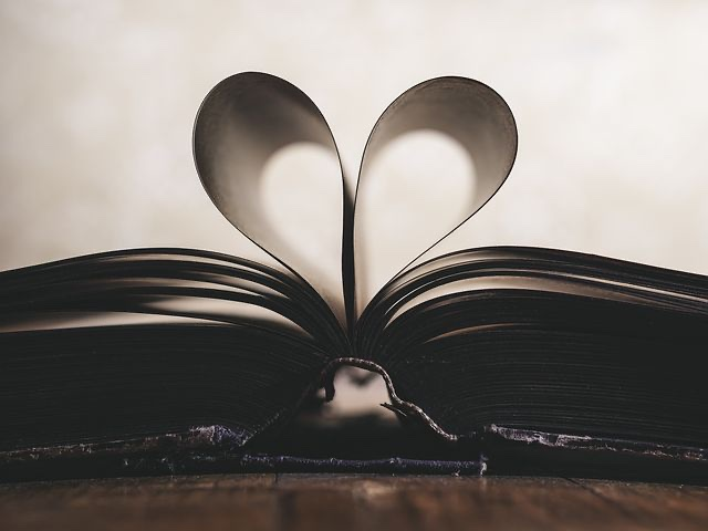 A book with pages folded into a heart.