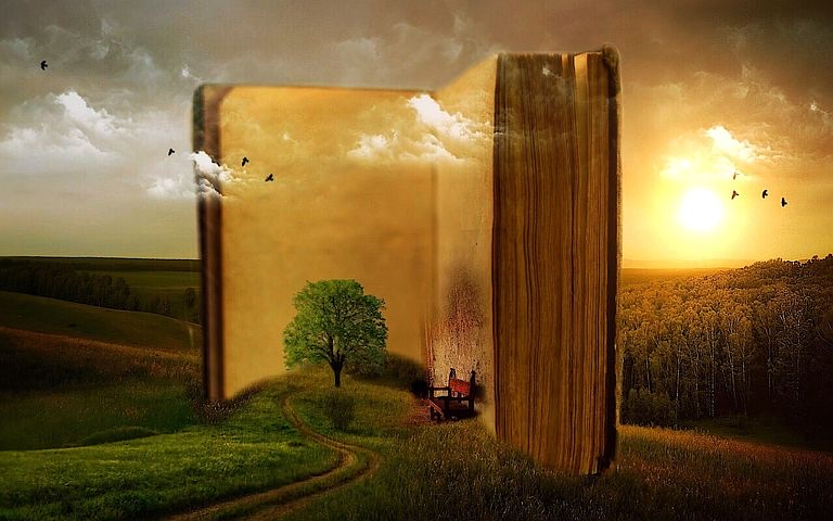 A landscape with a book on the horizon and a small tree growing inside it.