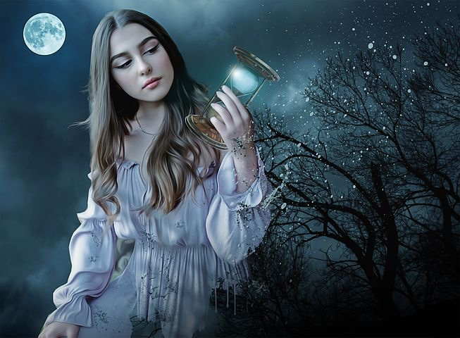Pale, brunette woman holding an hourglass in moonlight with a shimmering tree behind.