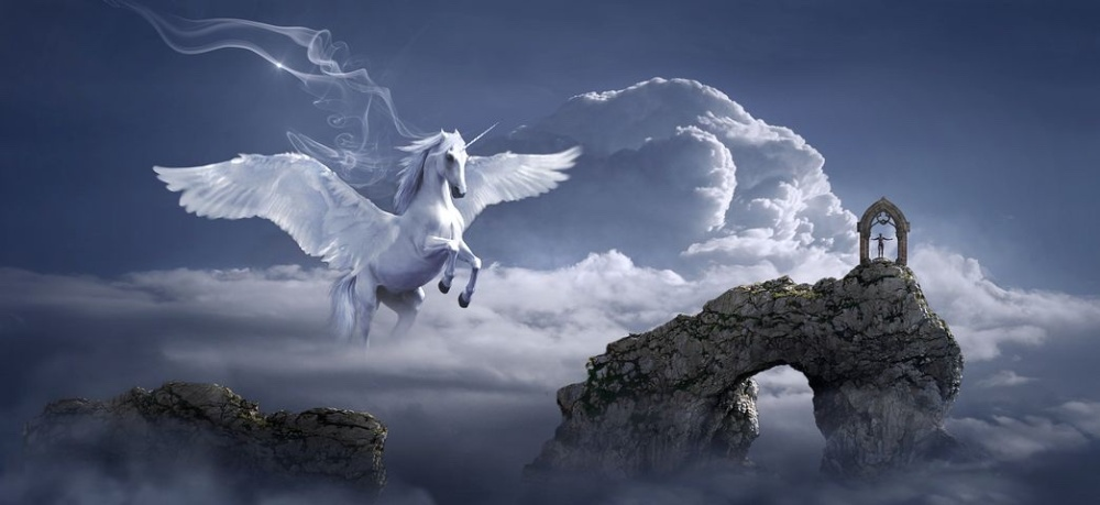 Pegasus flying in a medium blue, cloudy sky over a crumbling stone arch.
