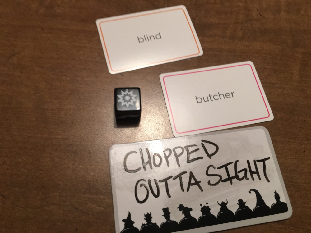 Image Description: the starburst action die with the cards Blind + Butcher. The whiteboard says, Chopped: Outta Sight.