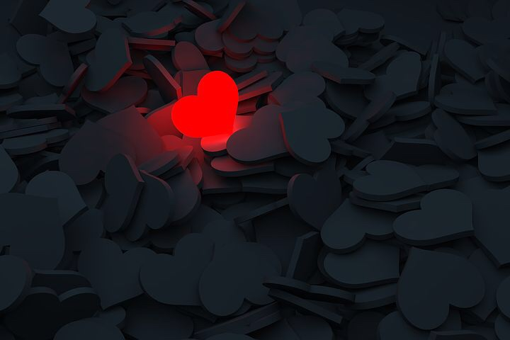 Image: One lit up red heart light among many dark ones.