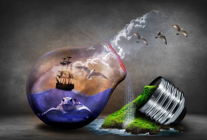 A fantastical, broken lightbulb with a ship on an ocean, and green grass bursting forth.